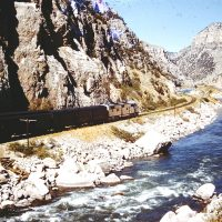 A Colorado & Southern train northbound in the Windriver Canyon in Wyoming during the 1960s